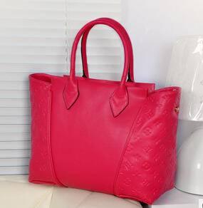 欧美潮包包真皮包女包手提斜挎压花牛皮女包源自欧美设计师 时尚包邮