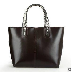 新款手提包大包水桶包手提欧美时尚女包牛皮强士利包邮1211