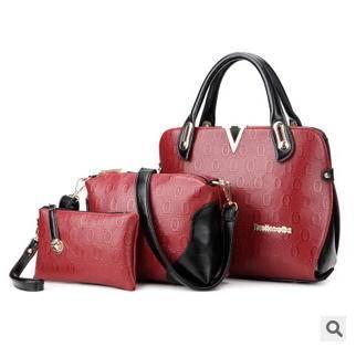 单肩斜跨女士包包欧美时尚新款v字压花手提包征途包邮