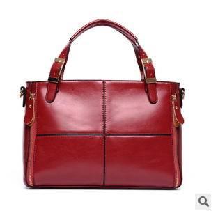 单肩斜挎大容量女包欧美时尚新款油腊皮拼接女士手提包征途包邮